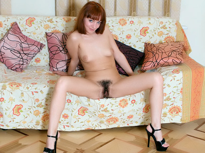 Redhead Hottie Exposes Her thickening Bush